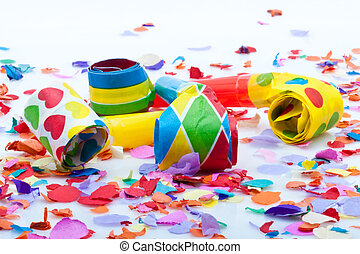 noisemakers for a party isolated on white background with confetti