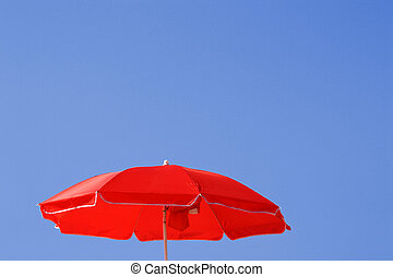 colorfull sunshades at the beach in the summer