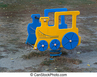 Train spring rider  in  a Playground