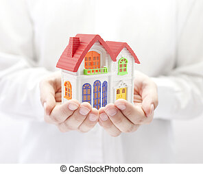 colorido, casa, en, manos