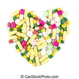 colorido, droga, píldoras, en forma, de, corazón, blanco, plano de fondo, farmacéutico, concepto
