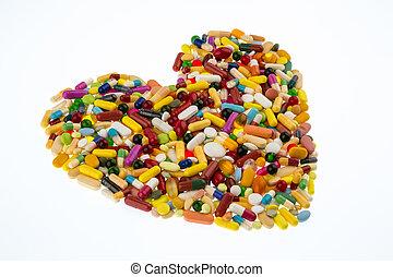 colorido, píldoras, en, forma corazón