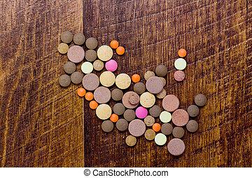 coloridos, pílulas, ligado, madeira, fundo