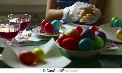 Coloring easter eggs - Woman coloring easter eggs.