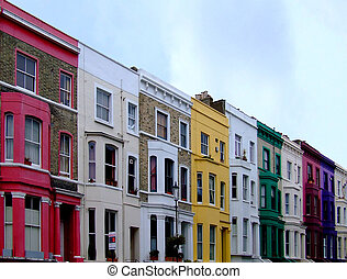 Buildings in a row in multi color walls