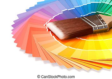 colors - paintbrush with paint swatches over white...