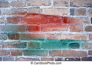 colors painted on grunge brick wall background