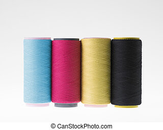 Colors, spools of thread on a white background
