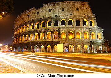 Colosseum in Rome at night - view over street