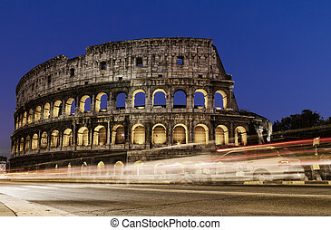 Colosseum in Rome, Italy at night with trails from traffic