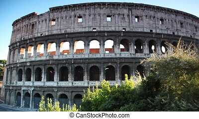 Colosseum or Flavian Amphitheatre in Rome, view from passing...