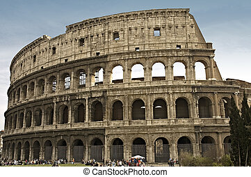 Colosseum or Flavian Amphitheater ,the first permanent amphitheater to be built in Rome, Italy with people in front. Note : No recognizable person