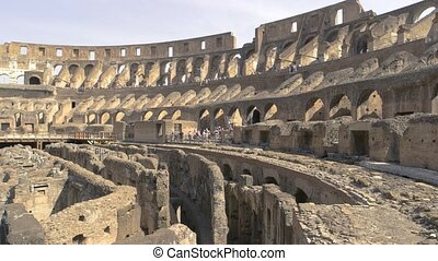 Colosseum ruins and people. Landmark of Rome.