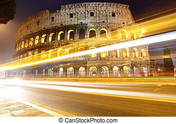 Colosseum - The Colosseum at night and traffic lights, Rome,...