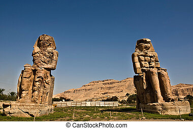The twin statues depict Amenhotep III (fl. 14th century BC) in a seated position