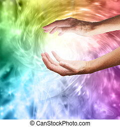 Outstretched healing hands on vivid rainbow vortex swirling energy background