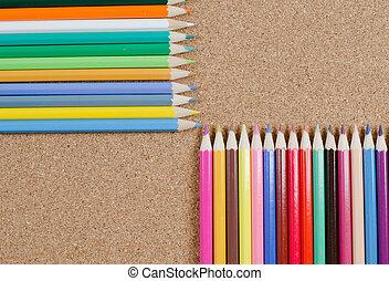 Colour pencils on ?orkboard - The colour pencils on...