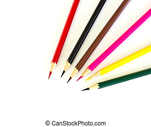 Colour pencils on white background close up