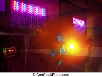 Colour spotlights illumination on scene in the dark