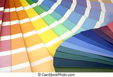 Paint swatches fanned out to reveal various colours