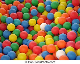 coloured plastic balls in bouncy castle