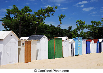 Coloured Beach huts under the sunlight II