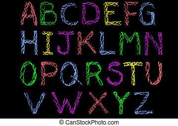 Coloured chalk handwritten letters alphabet on blackboard -...