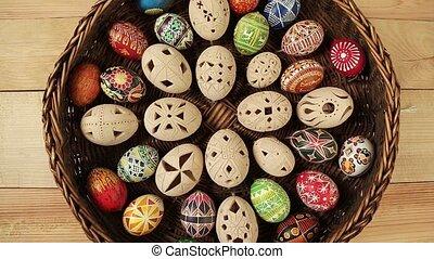 Coloured eggs in Easter nest