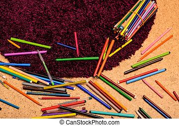 Coloured pencil on children floor white background.