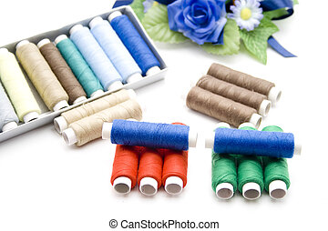 Coloured sewing cotton with rose - Coloured sewing cotton...