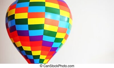 coloured toy air ball revolves on white background