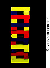 Coloured Wooden Blocks Stacked Against a Black Background