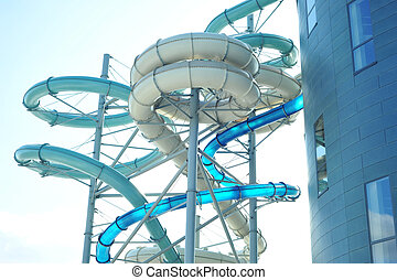 aquapark - colourful aquapark pipes and blue sky
