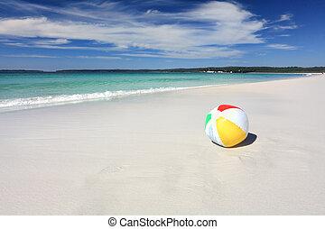 Colourful beach ball on the seashore by the ocean - A ...