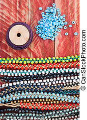colourful bead making bracelets