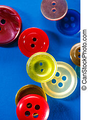 Colourful buttons on blue background