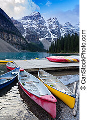 Colourful canoes docked at Moraine Lake