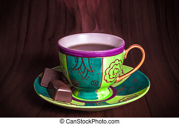 Colourful cup of hot coffee with chocolates