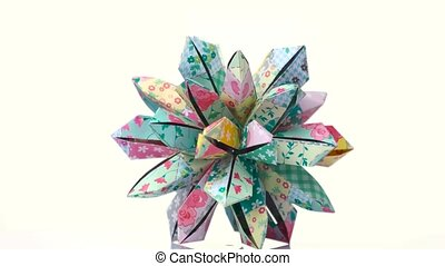 Colourful decorated origami transforming spiky ball. Bright...