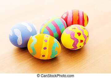 Colourful easter egg on wooden table