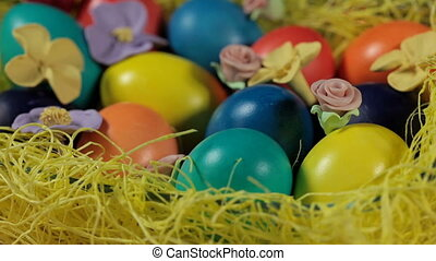 Colourful Easter eggs lying in a basket, close-up
