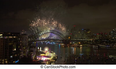 Colourful fireworks behind the harbour bridge - A steady...