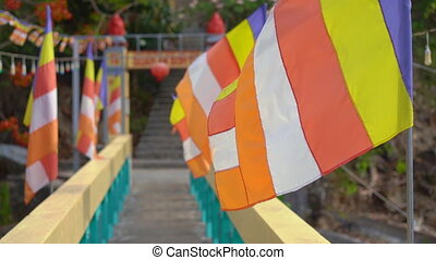 Colourful flags in a buddhist temple in Asia.