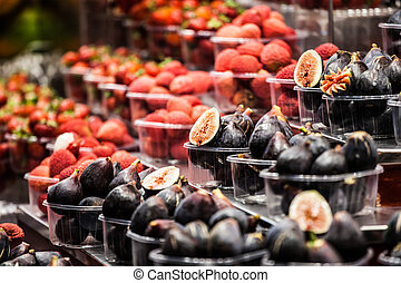 Colourful fruit and figs at market stall in Boqueria market...