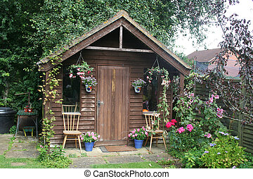 Colourful garden shed - Quaint garden shed with plants and...