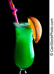 colourful green coctail on the black background, close up