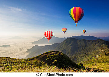 Colourful hot-air balloons flying over the mountain