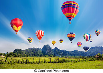 Colourful hot-air balloons flying