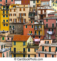 Colourful house frontings forming a beautiful background pattern. Cinque Terre - Italy.