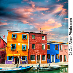 Colourful houses and boats, quaint village.